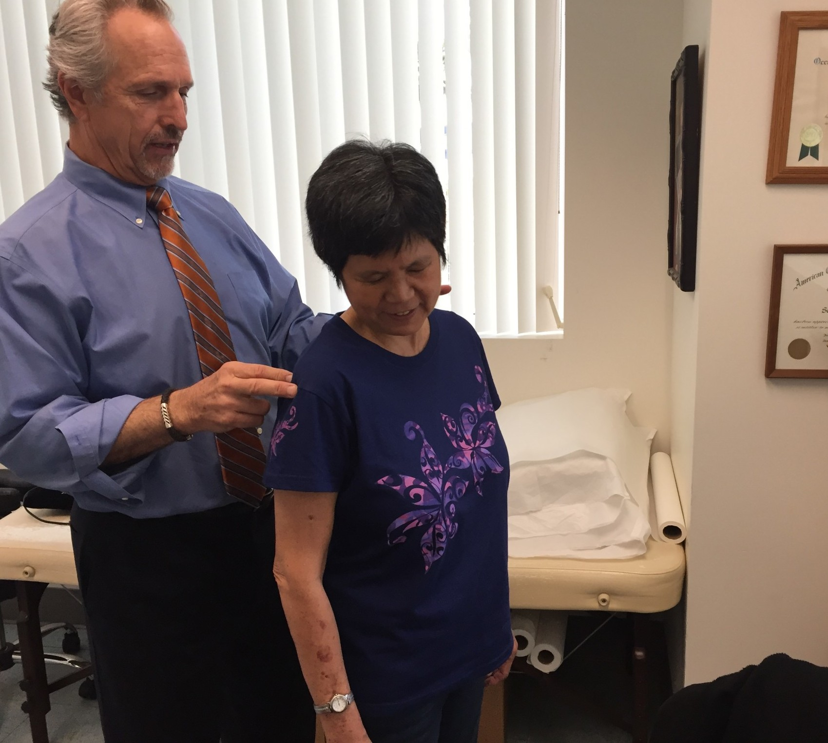 Dr. Scott McCaffrey examines Bonnie Chan at WorkStar Injury Recovery Center in Ewa Beach